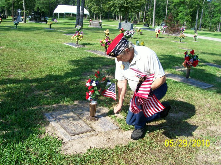 Click on Photo to view Gallery - Lee Derby Planting a Flag on Memorial Day